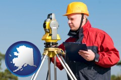 alaska map icon and a surveyor with transit level equipment