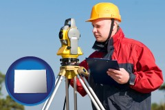Colorado - a surveyor with transit level equipment