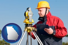 Georgia - a surveyor with transit level equipment