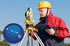 Hawaii - a surveyor with transit level equipment