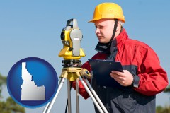 Idaho - a surveyor with transit level equipment