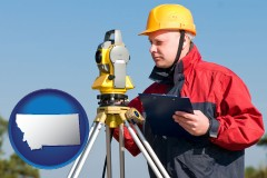 montana map icon and a surveyor with transit level equipment