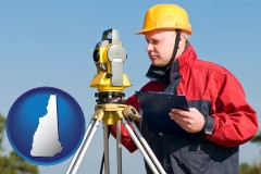 New Hampshire - a surveyor with transit level equipment