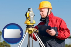 pennsylvania map icon and a surveyor with transit level equipment
