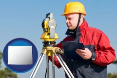 wyoming map icon and a surveyor with transit level equipment