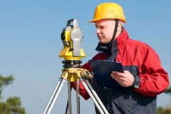 a surveyor with transit level equipment
