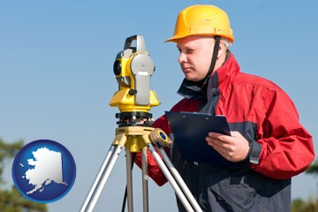 a surveyor with transit level equipment - with Alaska icon
