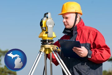 a surveyor with transit level equipment - with Michigan icon