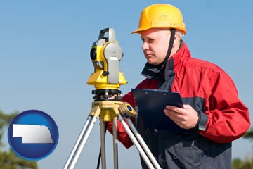 a surveyor with transit level equipment - with Nebraska icon