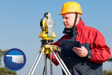 a surveyor with transit level equipment - with Oklahoma icon