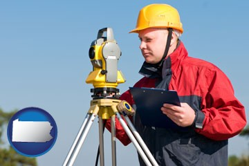 a surveyor with transit level equipment - with Pennsylvania icon