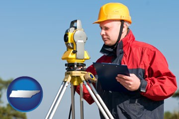 a surveyor with transit level equipment - with Tennessee icon