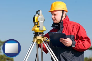 a surveyor with transit level equipment - with Wyoming icon